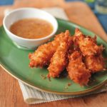 coconut crusted catfish strips with sauce