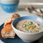 catfish chowder in bowl with side of bread
