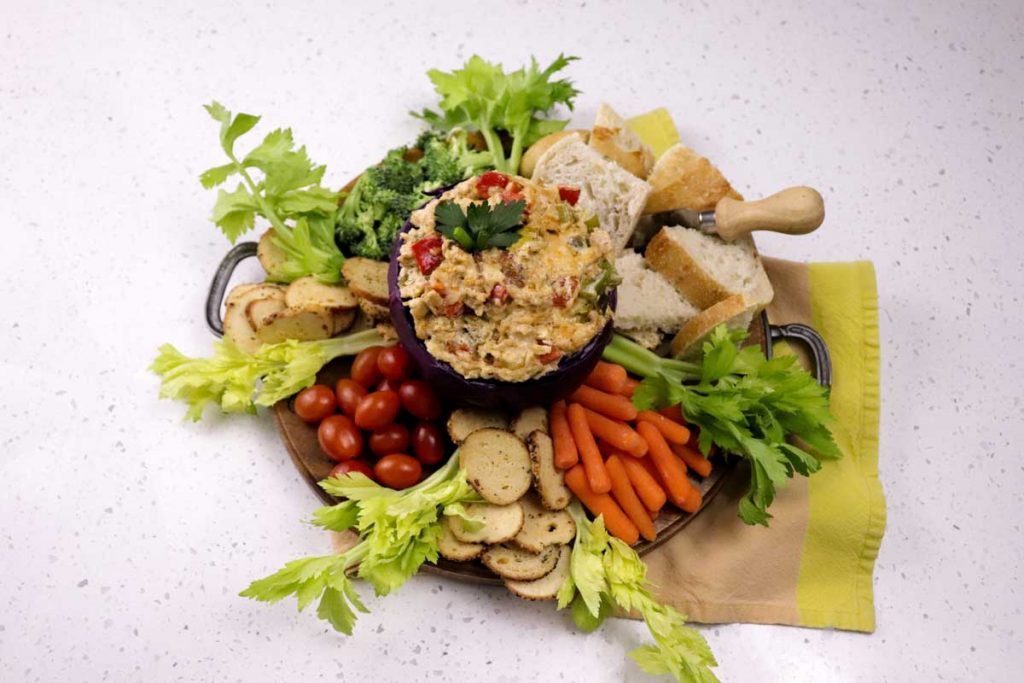 Catfish gumbo dip surrounded by vegetables and bread