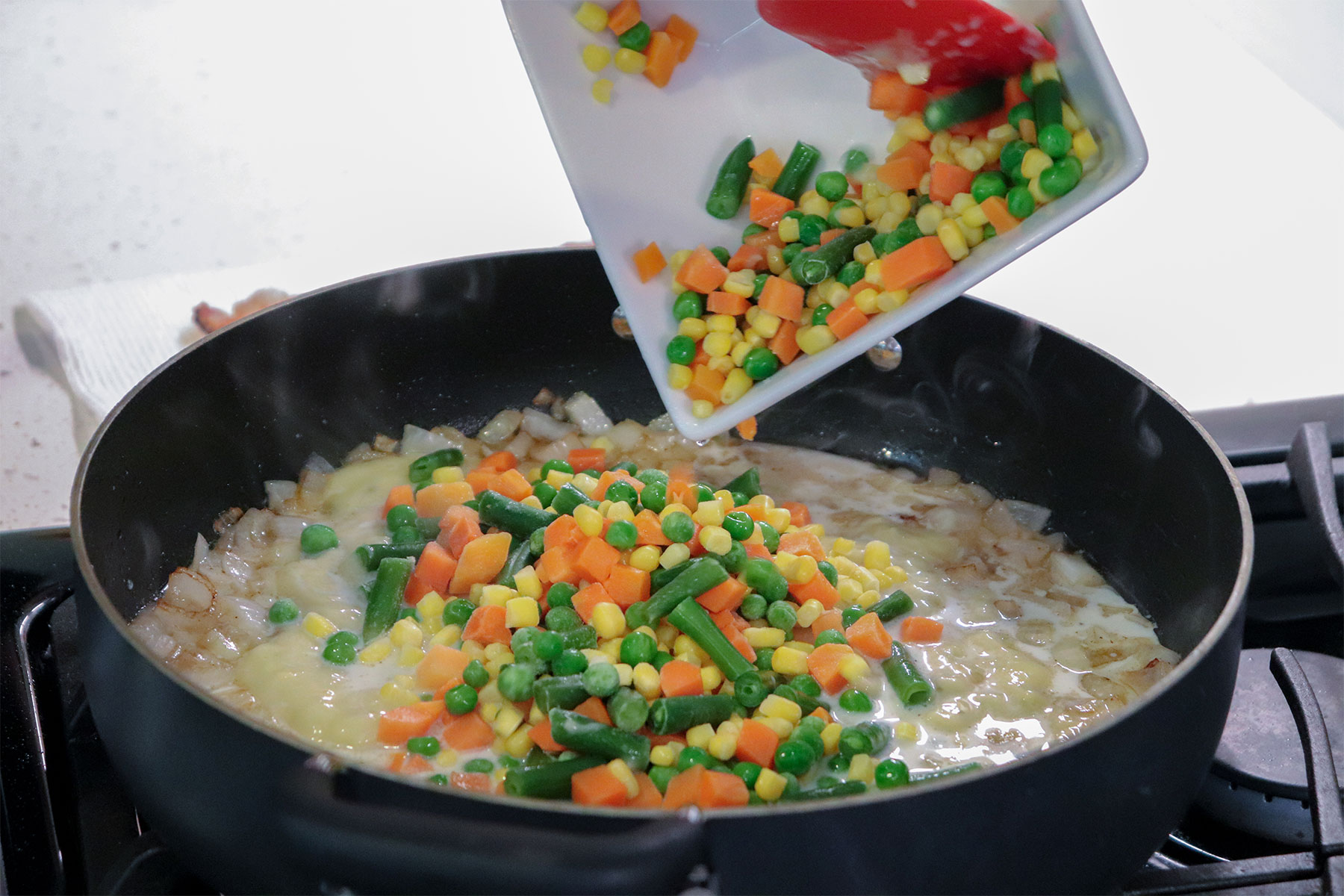 Adding veggies to cast iron skillet