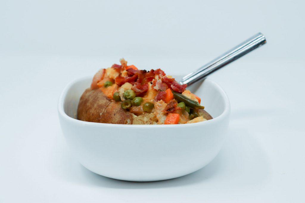 Catfish loaded baked Potato in bowl