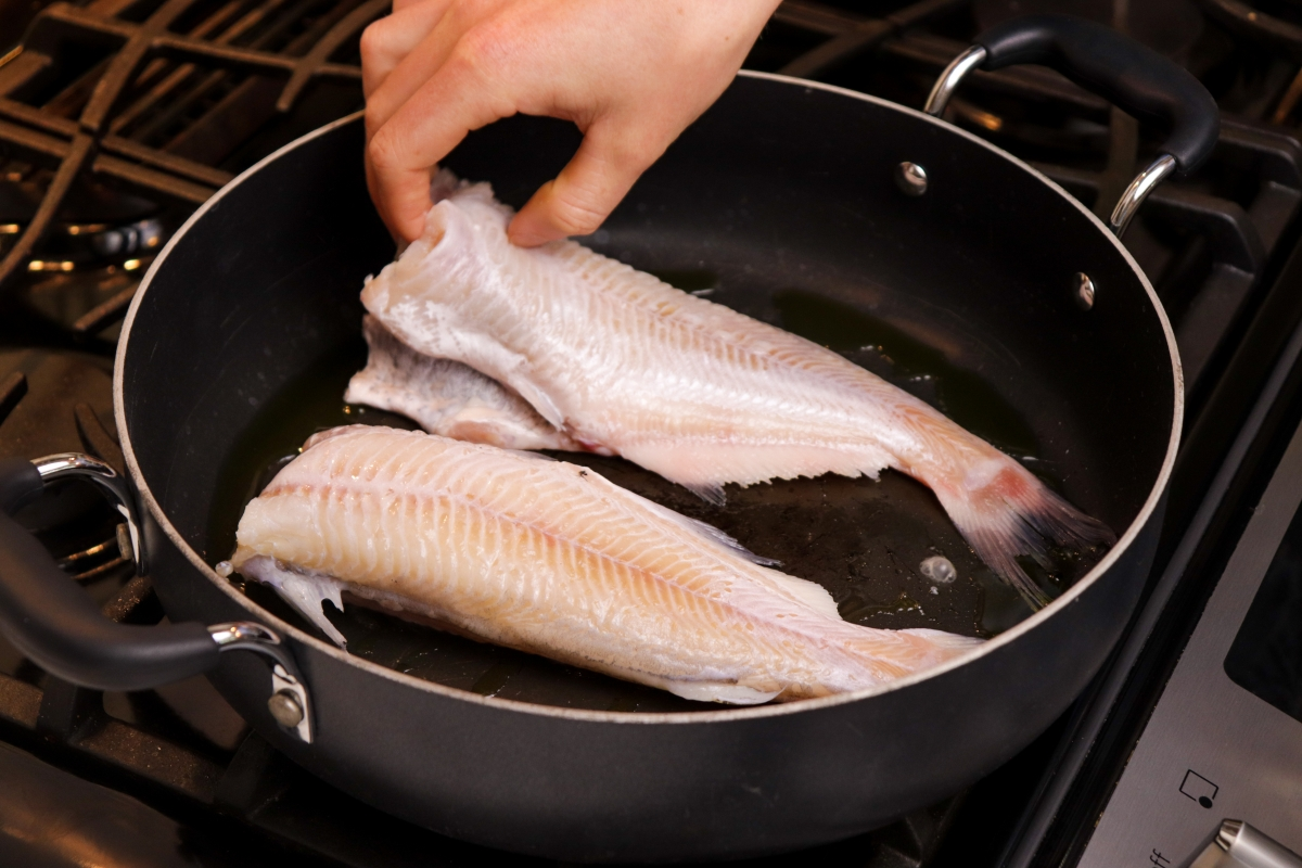 Sauteeing whole catfish in cast iron skillet