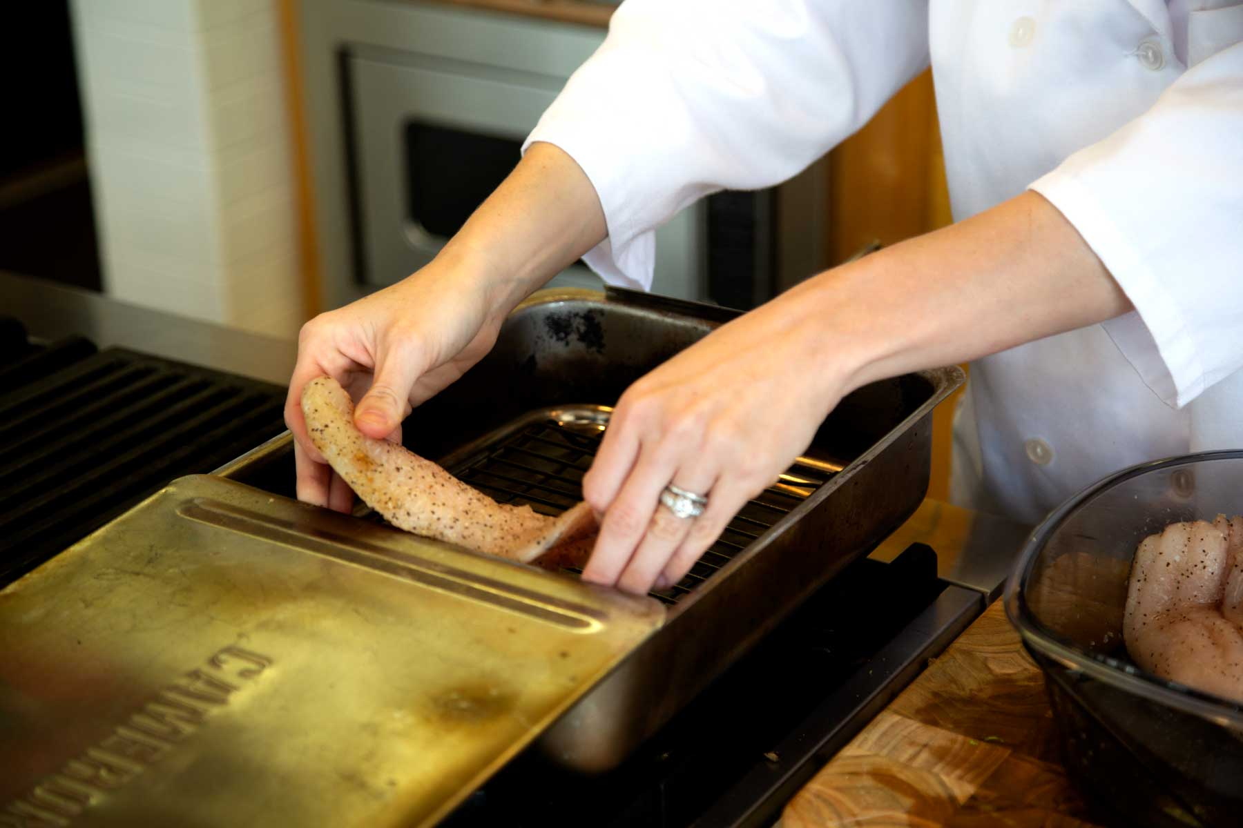 Placing Catfish fillets in Pan