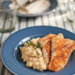 Blackened Catfish with mashed potatoes on a blue plate