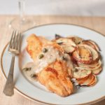 Catfish topped with Caper Sauce with scalloped potatoes