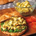 curry catfish salad on croissant with lettuce and tomato
