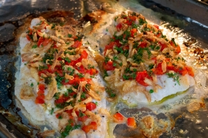 catfish topped with ingredients baking in oven