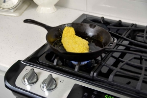 breaded catfish in a pan on stove