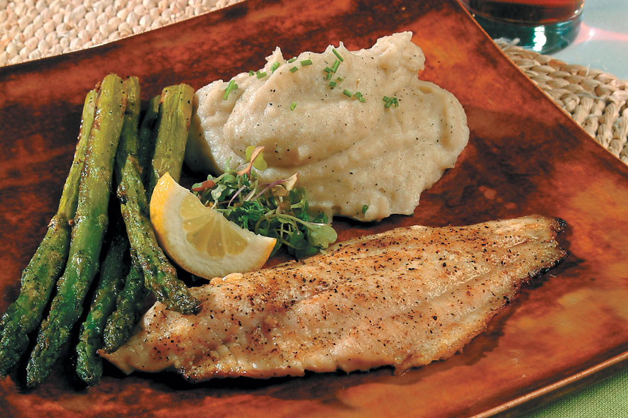 Broiled Catfish lightly seasoned with mashed potatoes and asparagus
