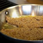 pecan crusted fillets cooking on stovetop