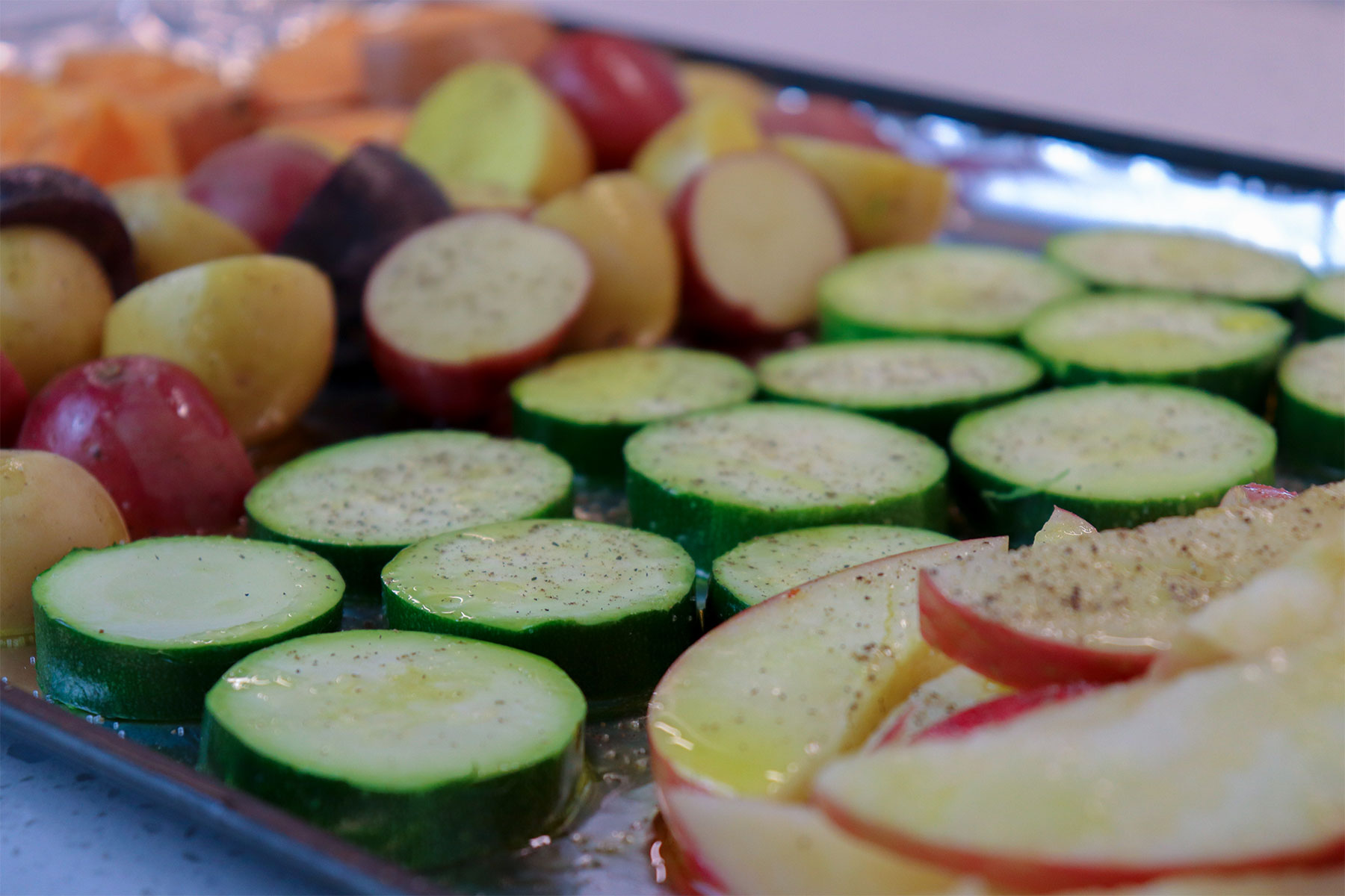 chopped Veggies on foil lined baking sheet