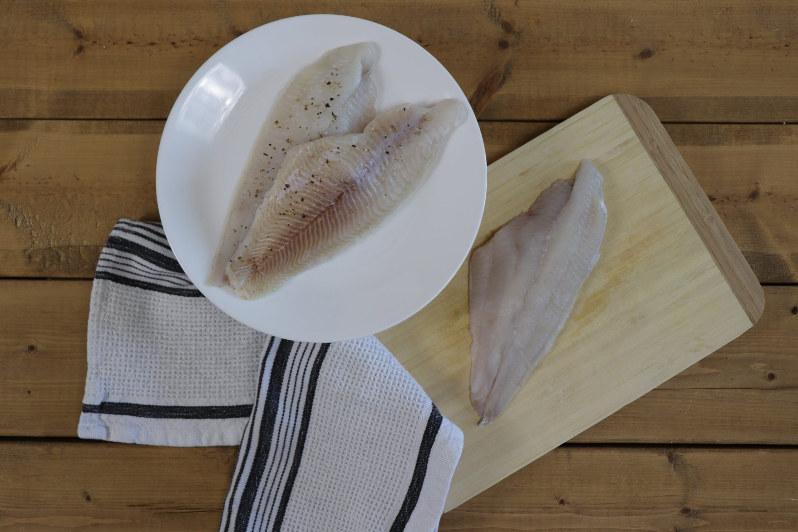 Raw Catfish on plate and cedar plank