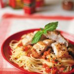 Lemon catfish pasta in red dish