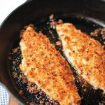 Onion Crusted Catfish cooking in cast iron skillet