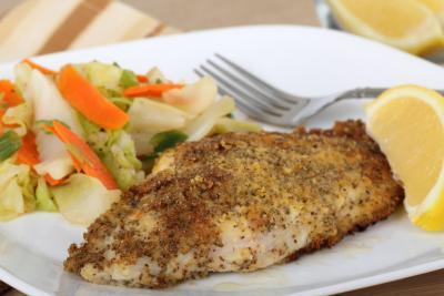 seasoned catfish fillet with side of veggies